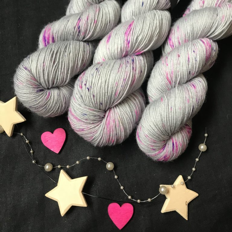 silver grey yarn with lots of pink and purple speckles