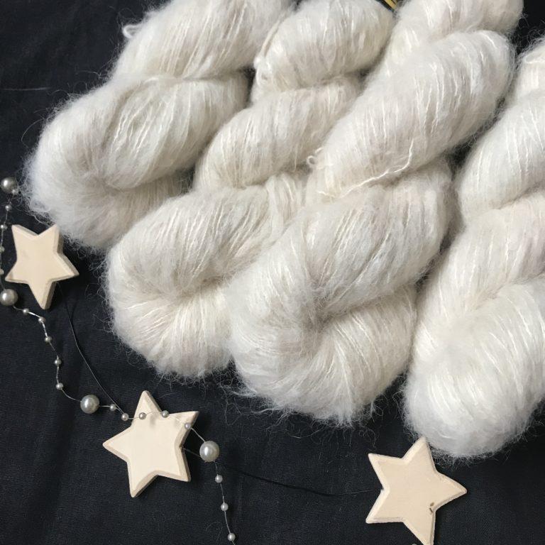 off white fluffy yarn, on a black background