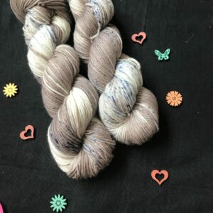 soft brown yarn with undyed patches speckles with grey and dark blue