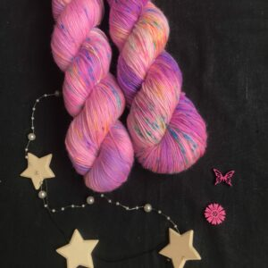 neon purple yarn, with darker and lighter patches, speckled with blue, neon orange and pink