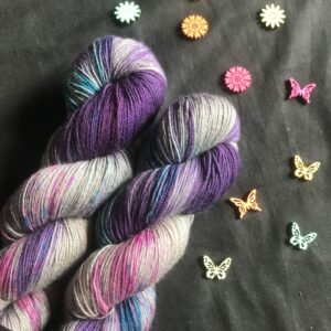 rich cadbury purple on a silvery yak base, with flashes of pink and blue