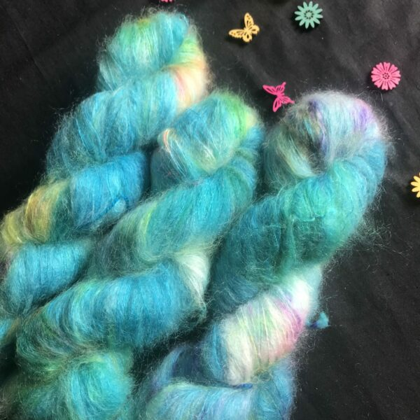 fluffy carribean blue yarn with white flashes and pops of neon orange, purple and green