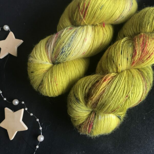 yellowy, olive base yarn with black and deep red speckles
