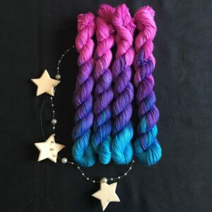 regular repeating mini skeins, moving from pink to dark purple to bright blue.
