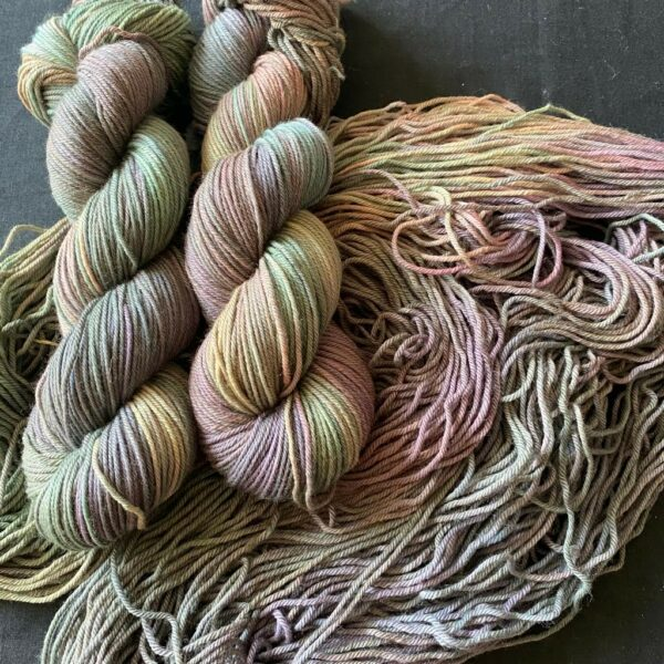 very variegated yarn, almost marble like, with murky greens, pinks, yellows. similar to the shades in an oil slick