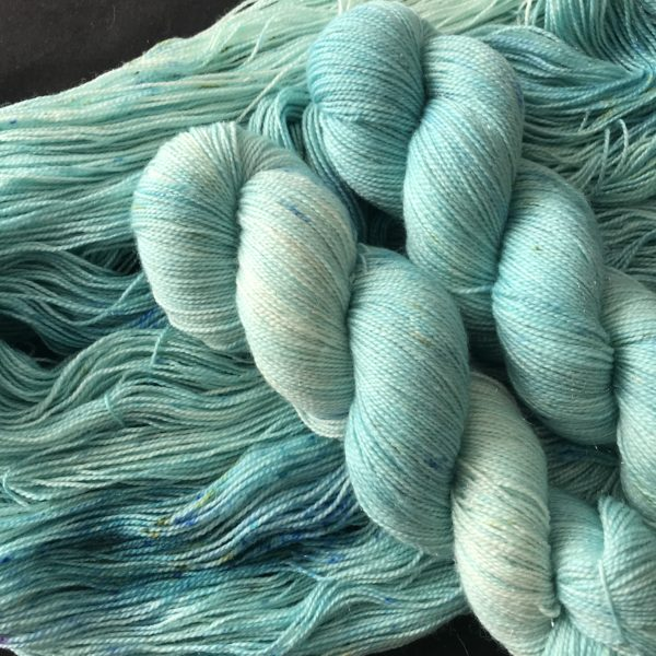 very pale jade tonal yarn with speckles of jade, blue and mint green