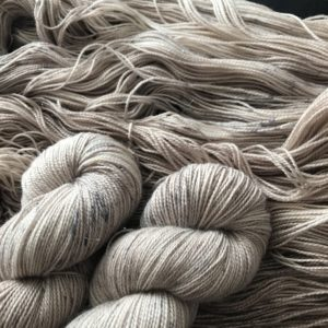 soft oyster/mushroom yarn with silvery, brown and navy speckles