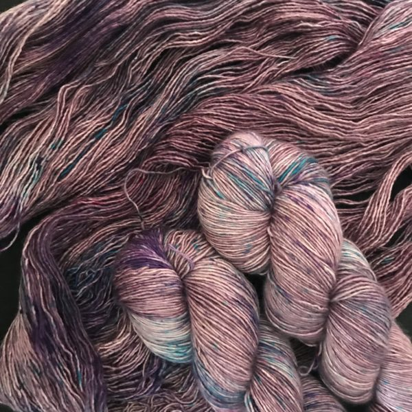 deep plummy yarn with speckles of purple. blue and pink.