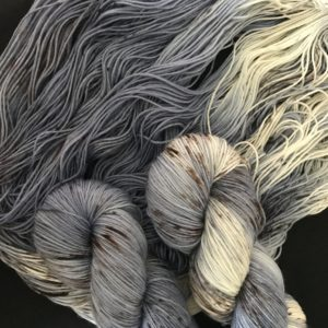 soft denim blue yarn with white sections, speckled with brown and grey